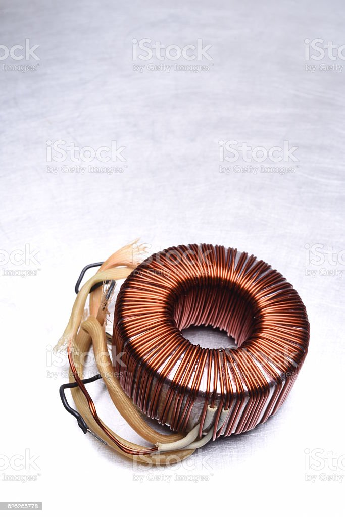 Copper Coil Transformer on Metal Background stock photo
