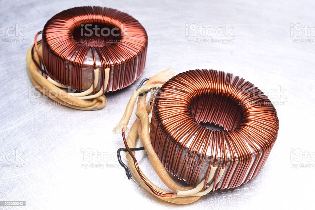 Copper Coils Transformer on Metal Background stock photo