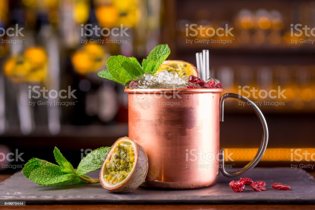 copper cup glass passion fruit cocktail stock photo