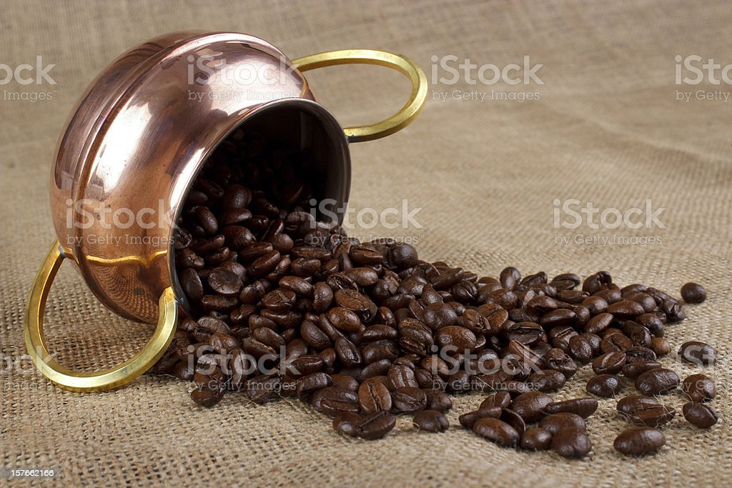 copper cup with coffee beans royalty-free stock photo