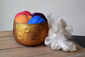 Copper glass bowl of colorful sheep wool fiber with natural fiber