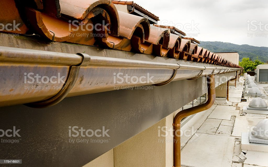 Copper Gutter with Tile Roof stock photo