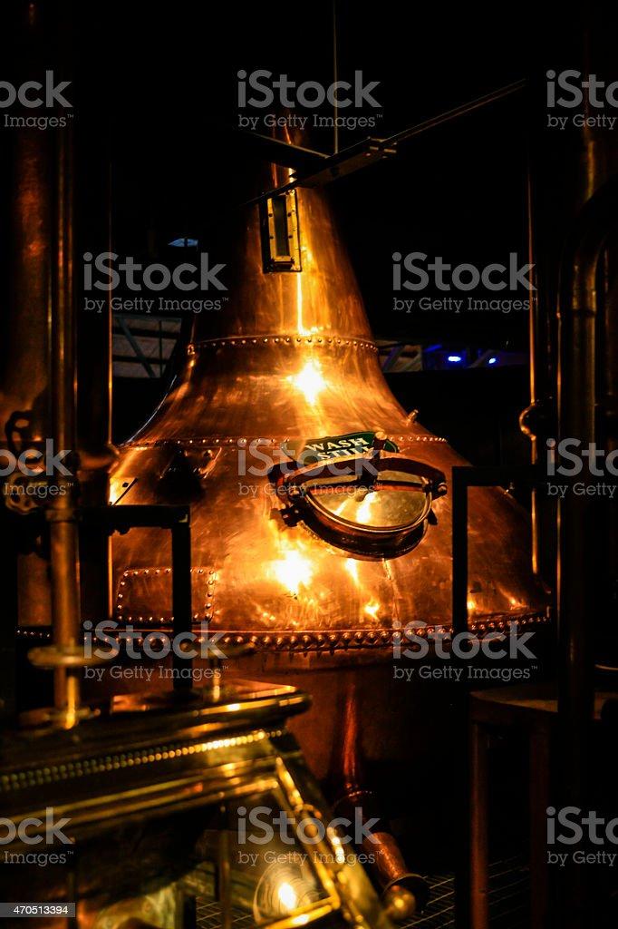 Copper metal vat in a dark distillery stock photo