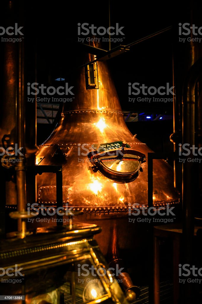Copper metal vat in a dark distillery stock photo