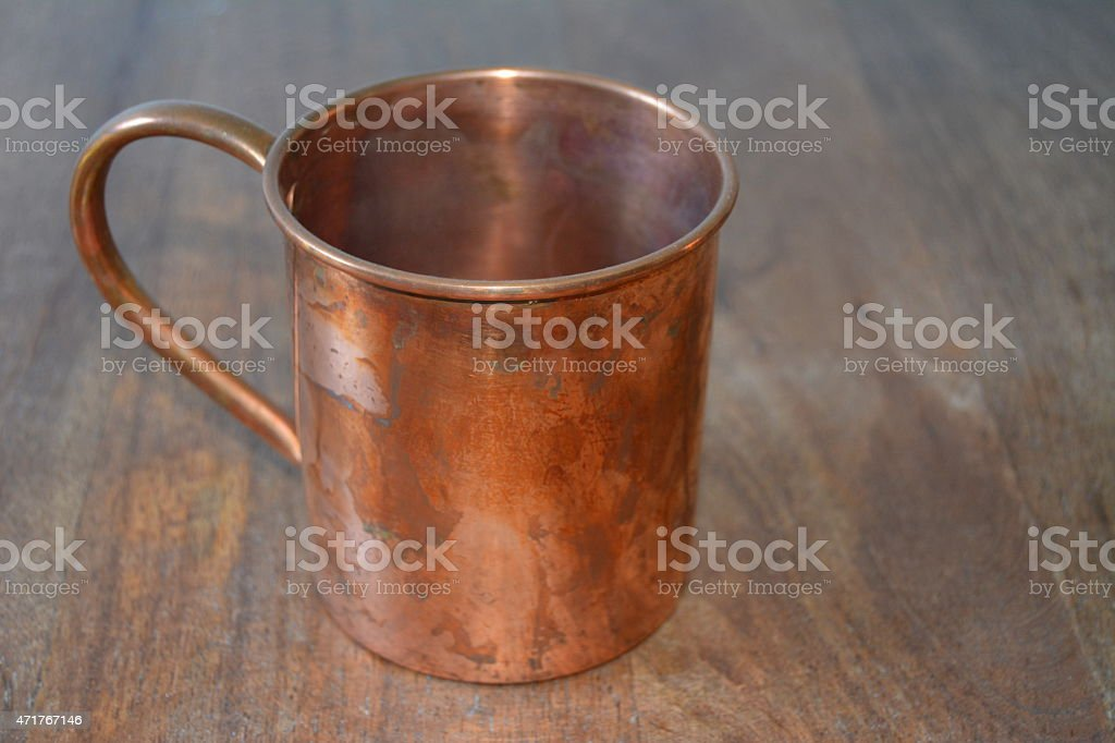 copper mug on a wood table stock photo