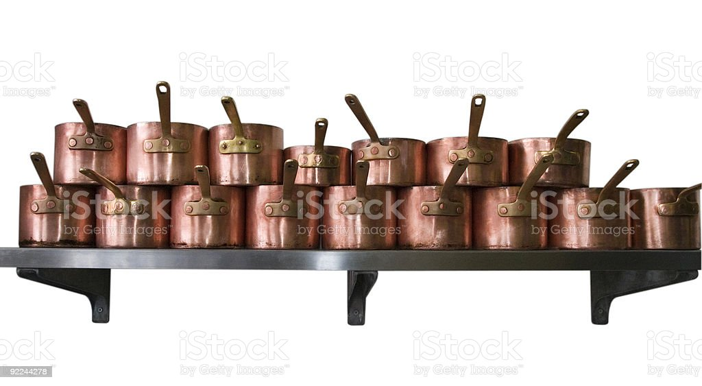 Copper pans on shelf royalty-free stock photo