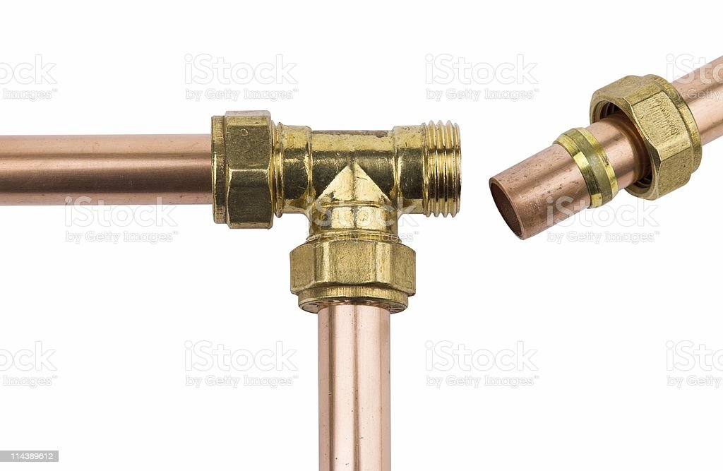 Copper pipe with brass compression T stock photo