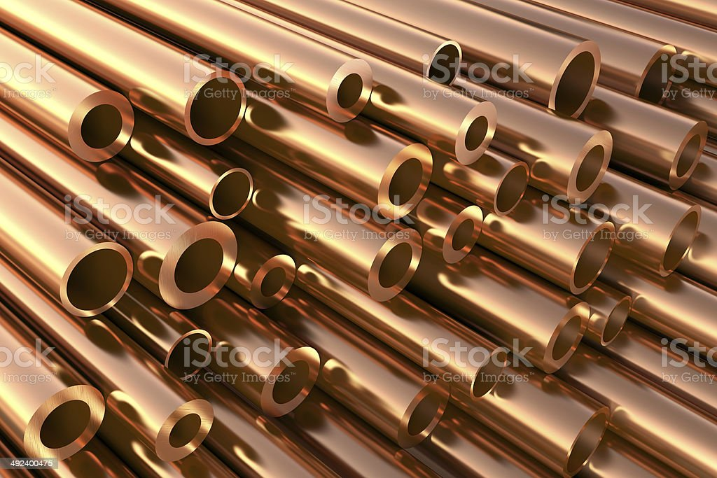 Copper pipes of different diameters in a warehouse stock photo