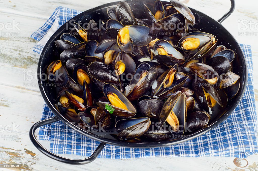 Copper pot of steamed mussels. stock photo