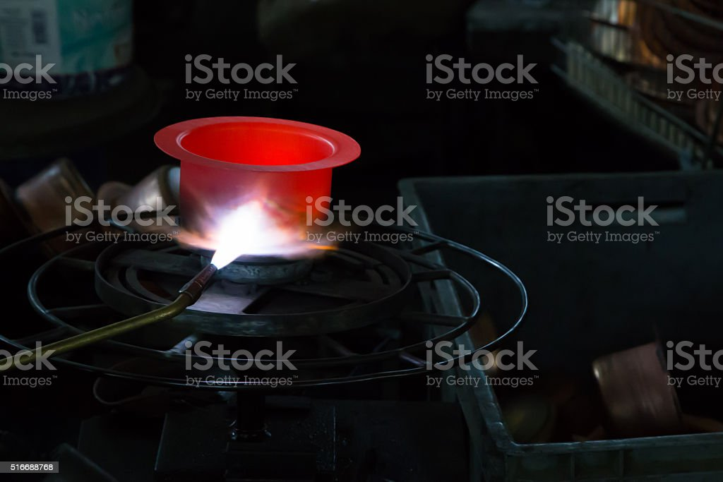 Copper pot production stock photo