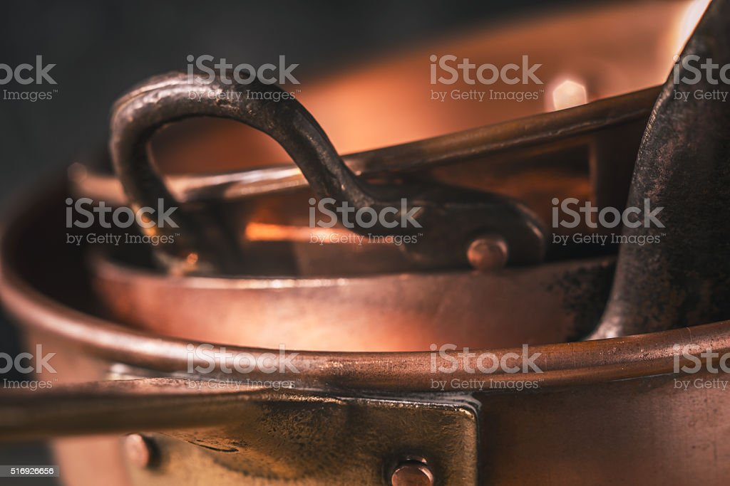 Copper pots and pans close-up stock photo