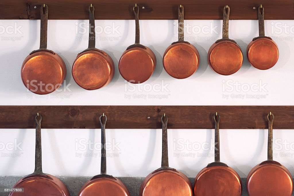 Copper pots and pans stock photo