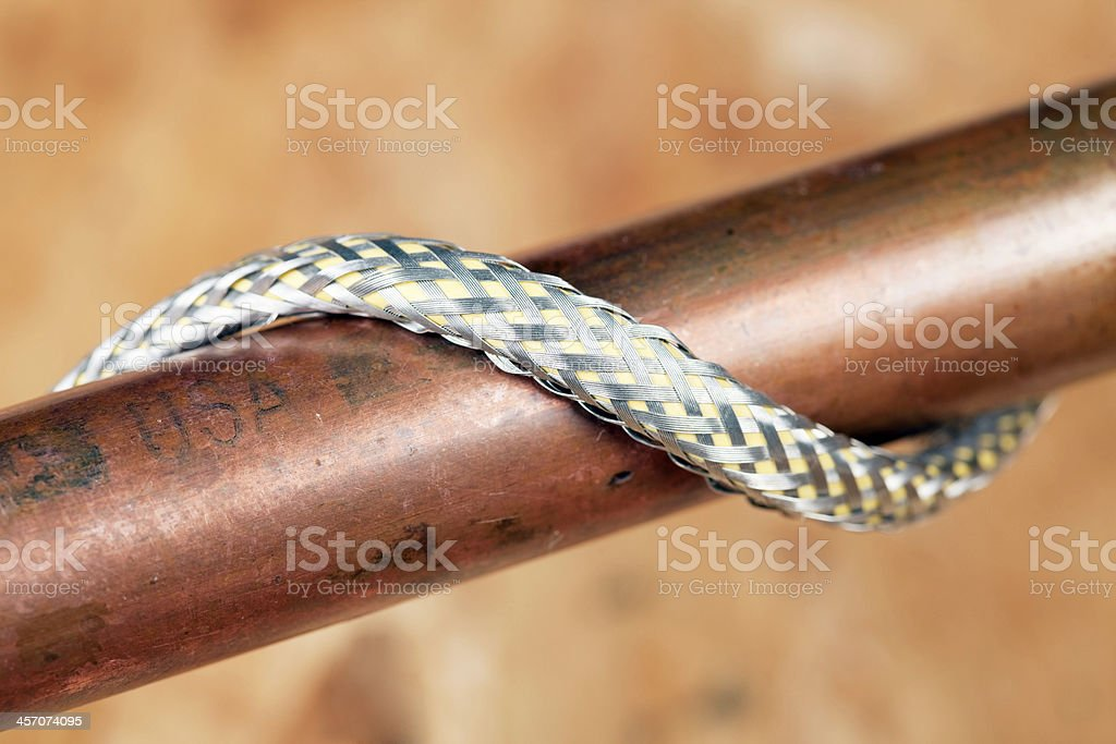 Copper Water Pipe Wrapped with Heating Cord stock photo