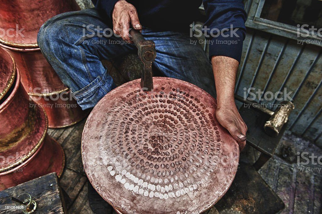 Coppersmith working stock photo