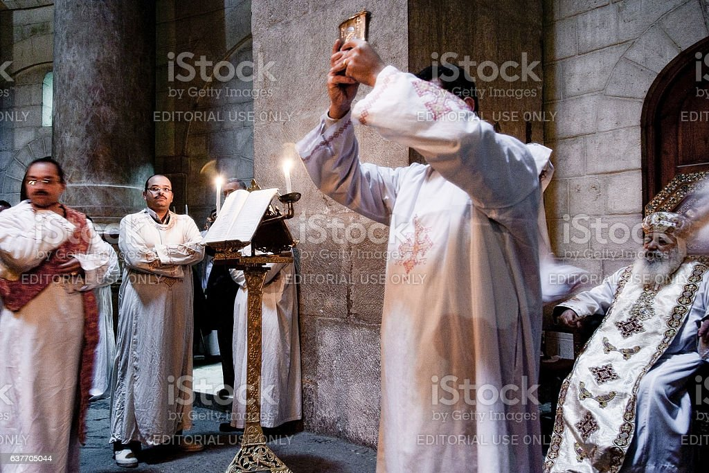 Coptic priests in Holy Sepulchre stock photo