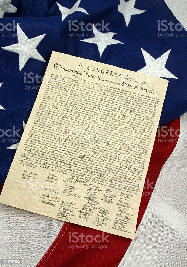 Copy of Declaration of Independence on American flag background. Vertical stock photo