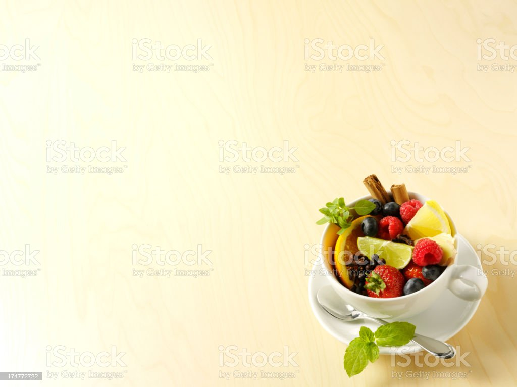 Copy Space and a Tea Cup of Fresh Fruit royalty-free stock photo
