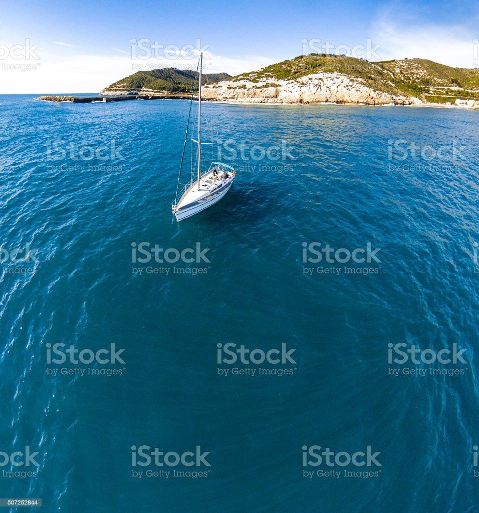 copy space boat sea aerial coast vessel blue sky costa stock photo