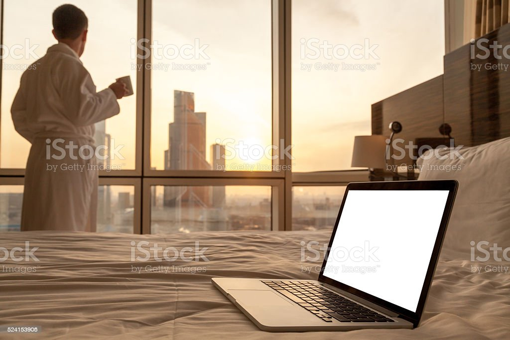Copy space laptop on the bed stock photo