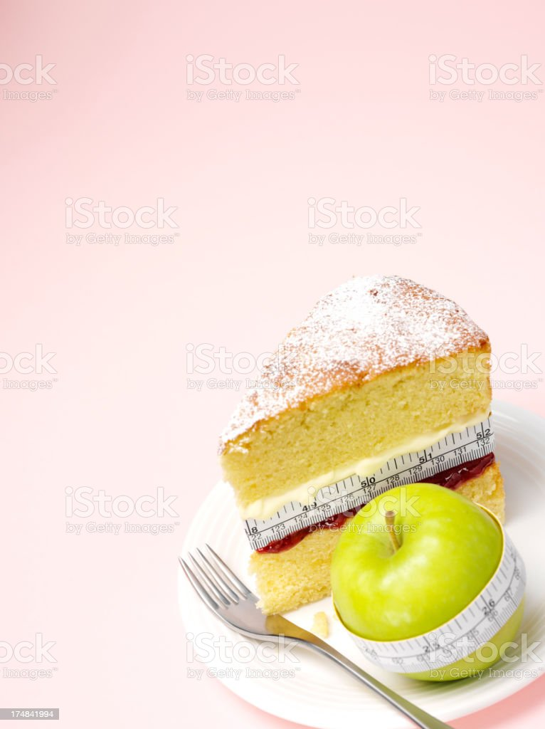 Copy Space with a Sponge Cake and Green Apple royalty-free stock photo