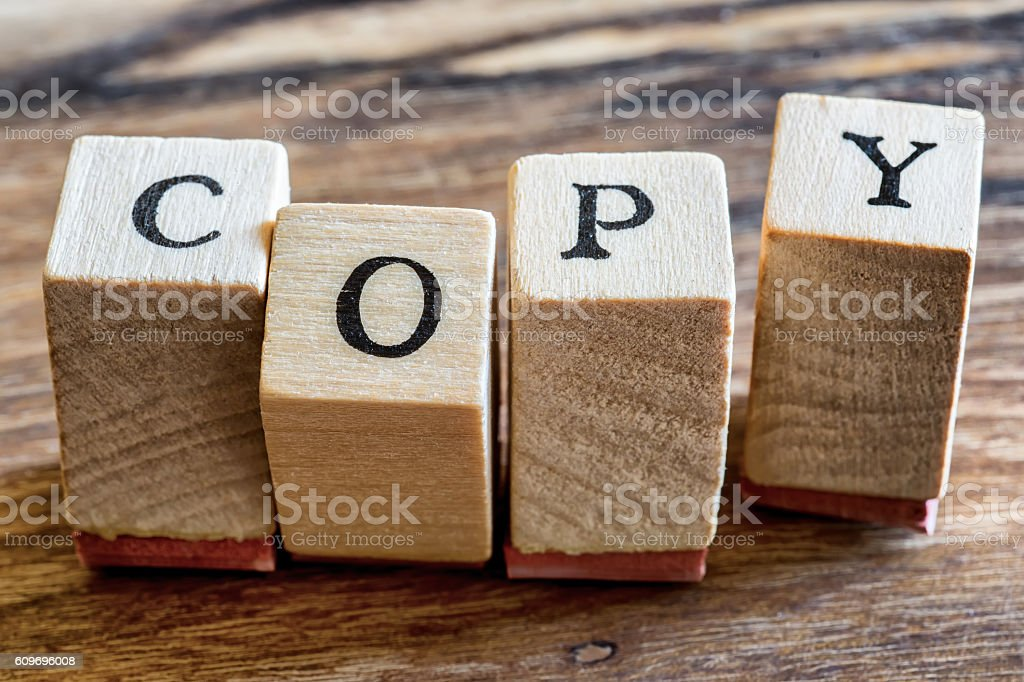 Copy Stamp on Woden Background. Copy Word in Wood Blocks stock photo