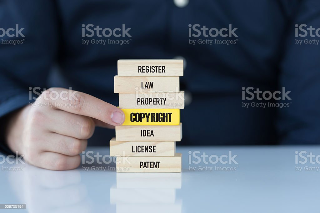 Copyright Concept with Related Keywords on Wooden Blocks stock photo