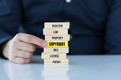 Copyright Concept with Related Keywords on Wooden Blocks