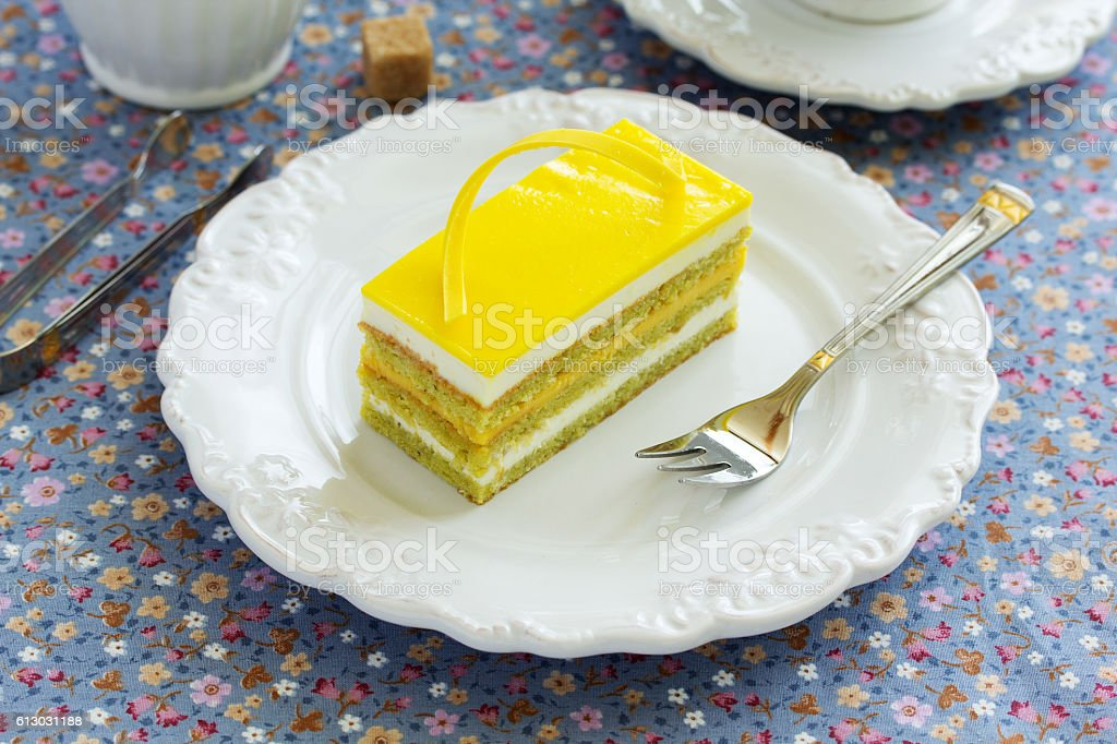 Copyright opera cake with pistachio and passion fruit. stock photo