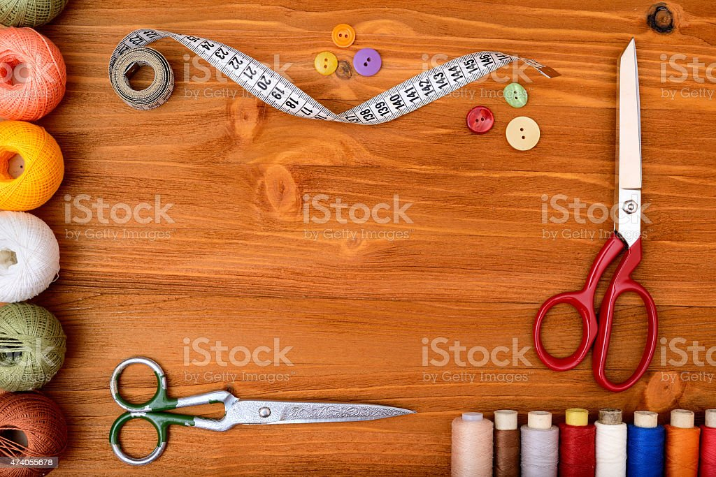 Copyspace frame with sewing tools and accesories on wooden background stock photo