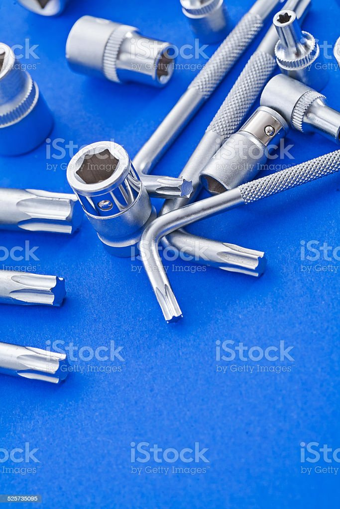 copyspace image torx and hexagonal keys on blue background stock photo