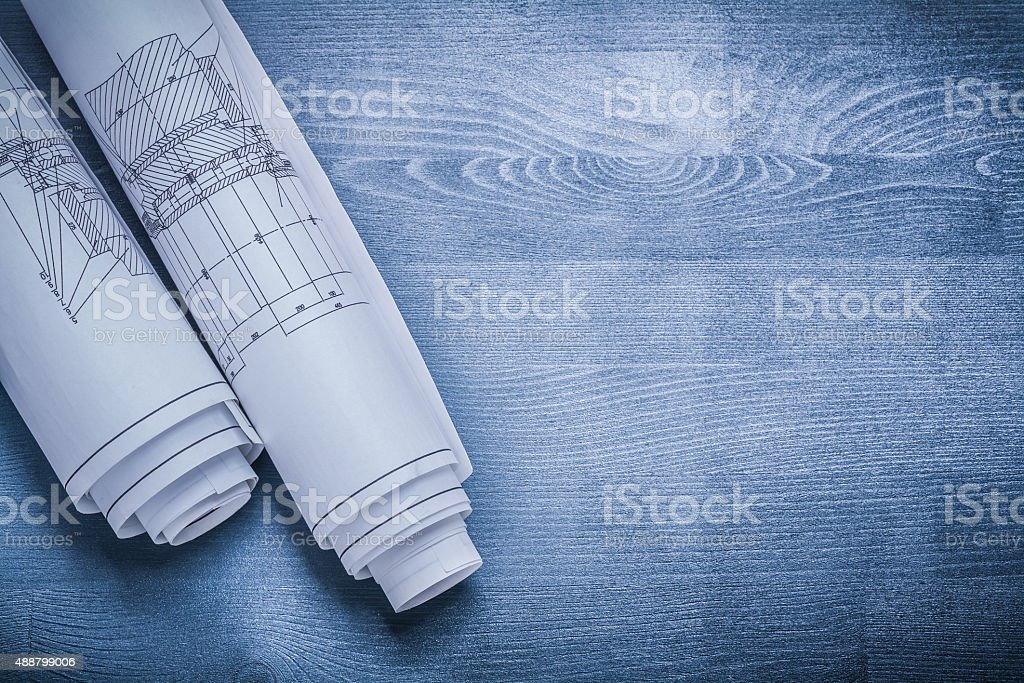 copyspace image white rolled blueprints stock photo