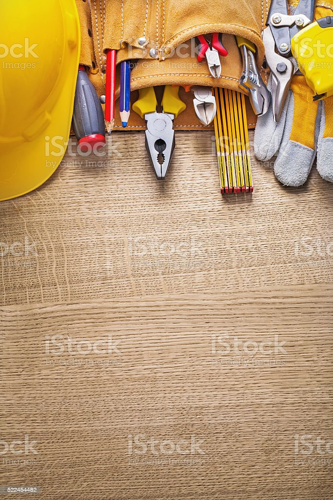 copyspace image working tools in toolbelt on wooden board stock photo