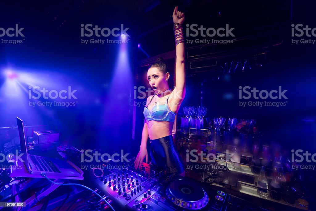 coquettish dance club DJ stock photo