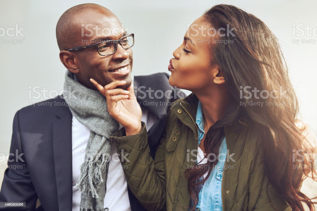 Coquettish young African American woman stock photo