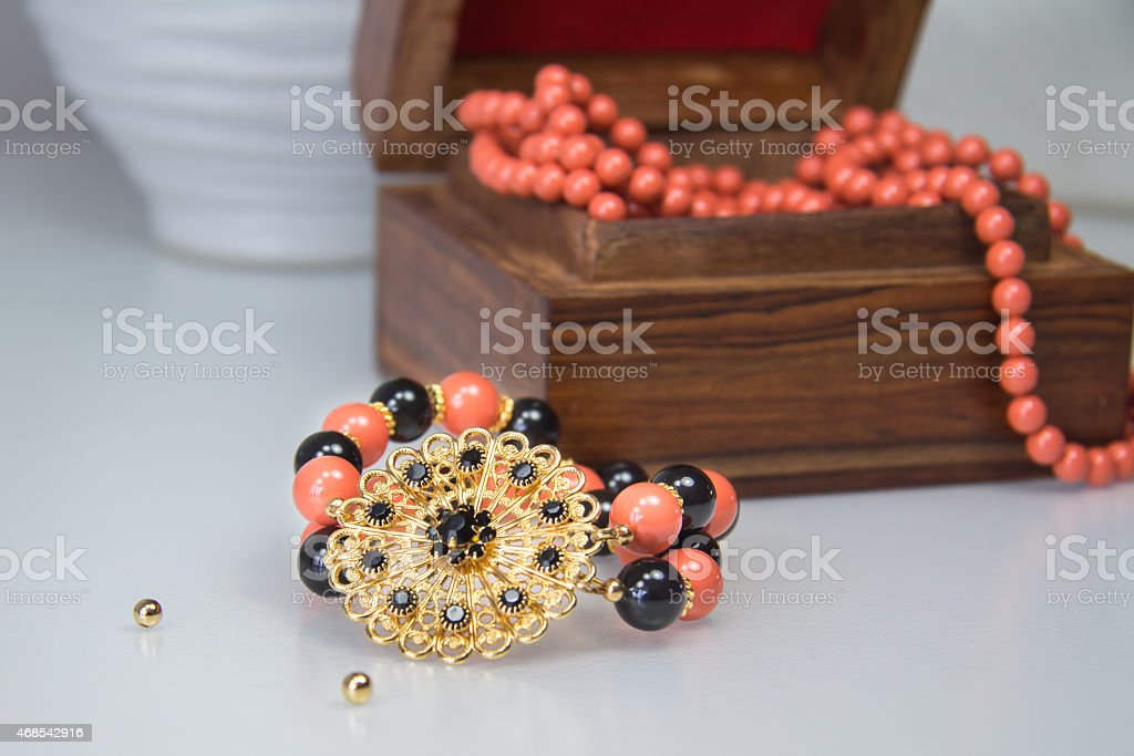 Coral and black beaded bracelet stock photo