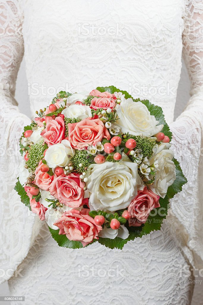 Coral and white wedding bouquet stock photo