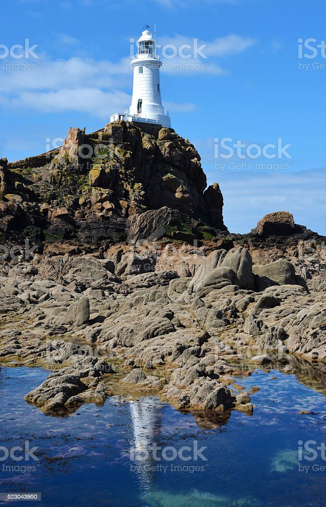 Corbiere Lighthouse and reflection stock photo