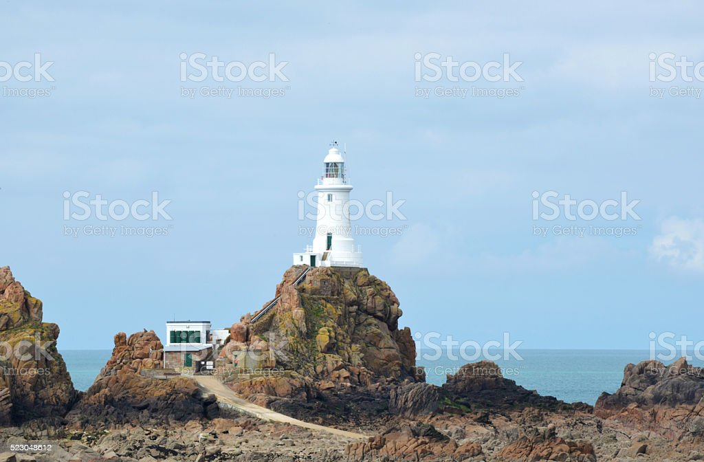 Corbiere Lighthouse on Jersey at Low Tide stock photo