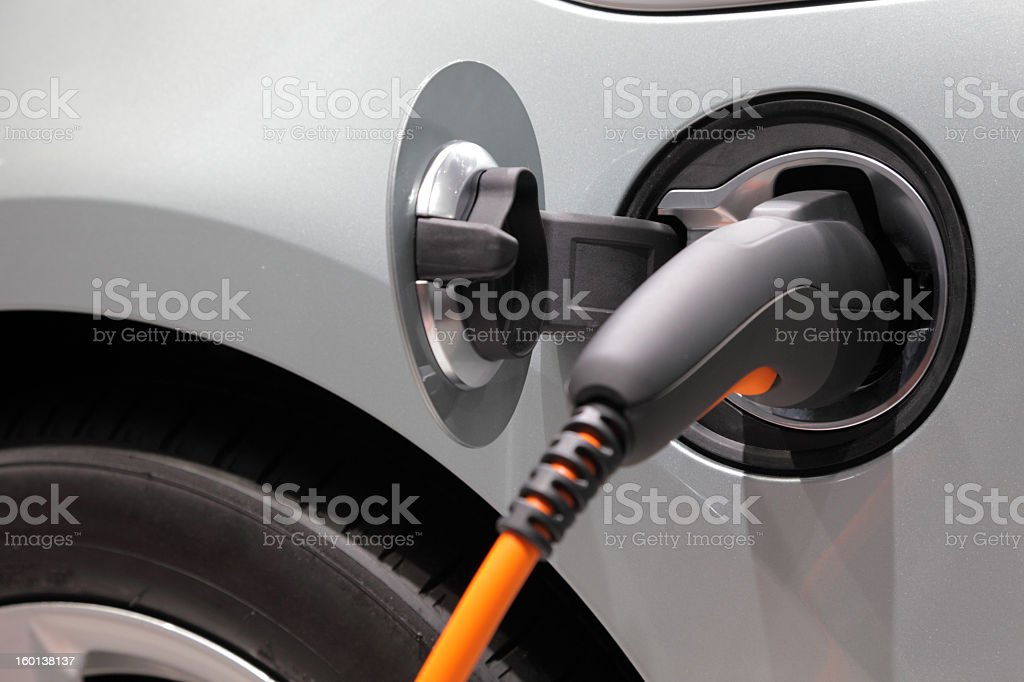 A cord charging an electric car stock photo