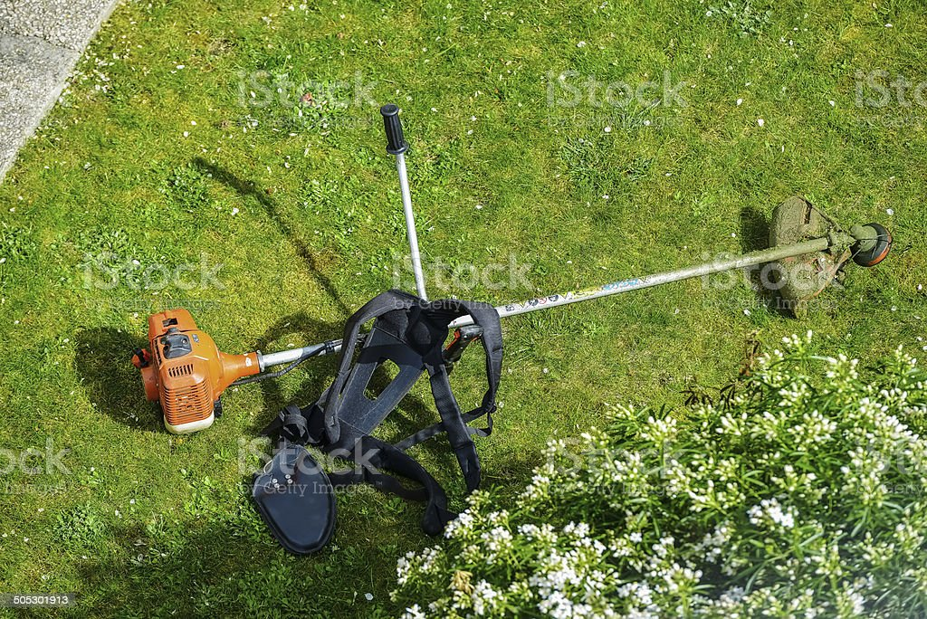 corded string trimmer in a park royalty-free stock photo