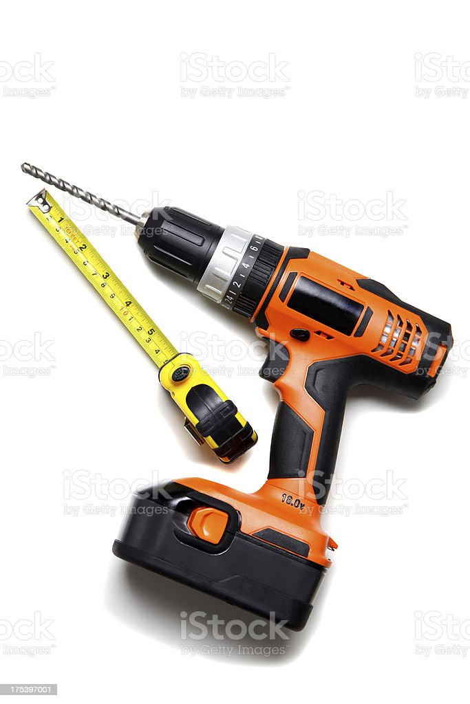 Cordless drill and tape measure royalty-free stock photo