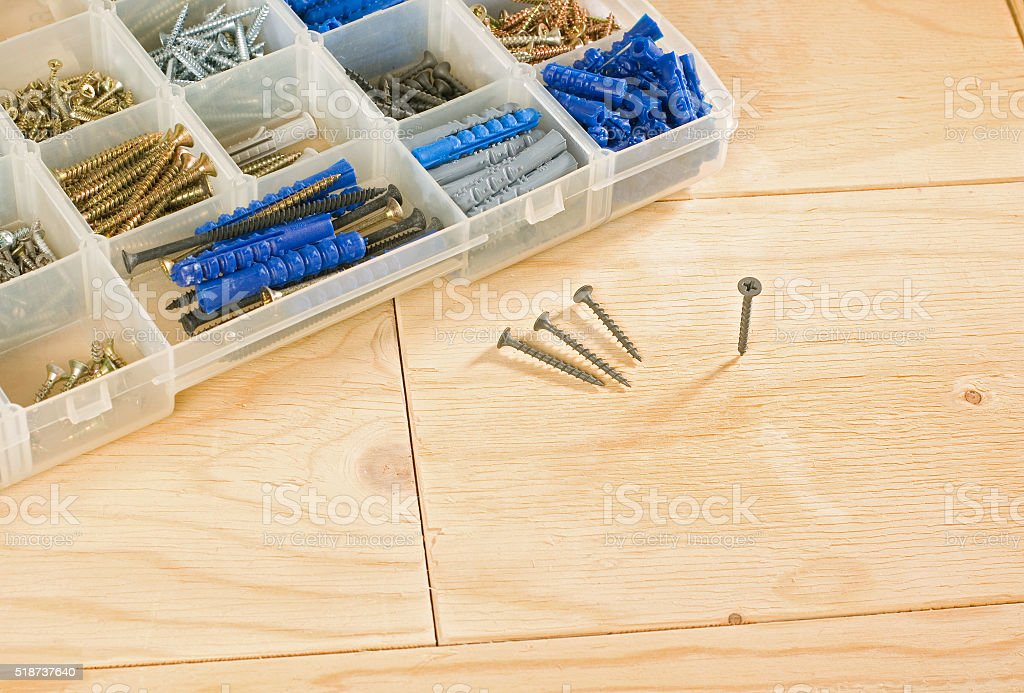 cordless drill, screws and toolbox stock photo
