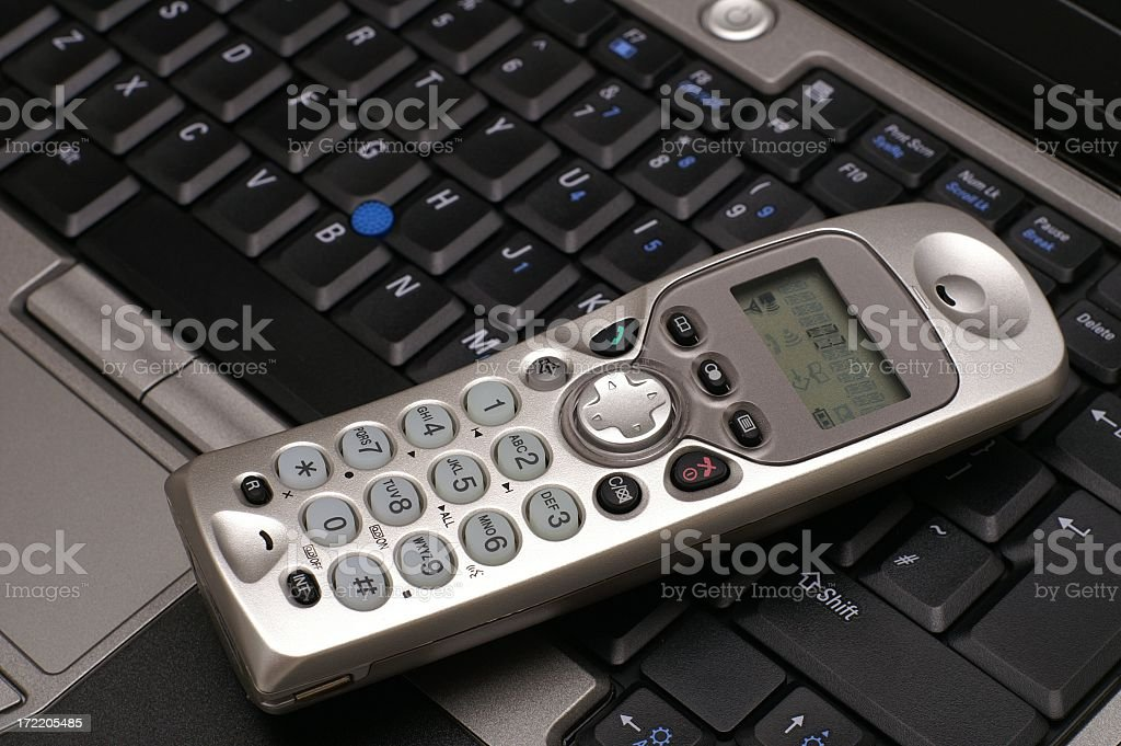 Cordless Phone on a Laptop stock photo
