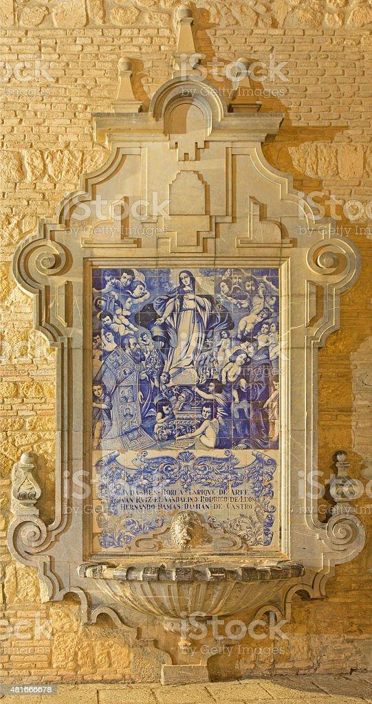 Cordoba - baroque fountain with the ceramic image Virgin Mary stock photo