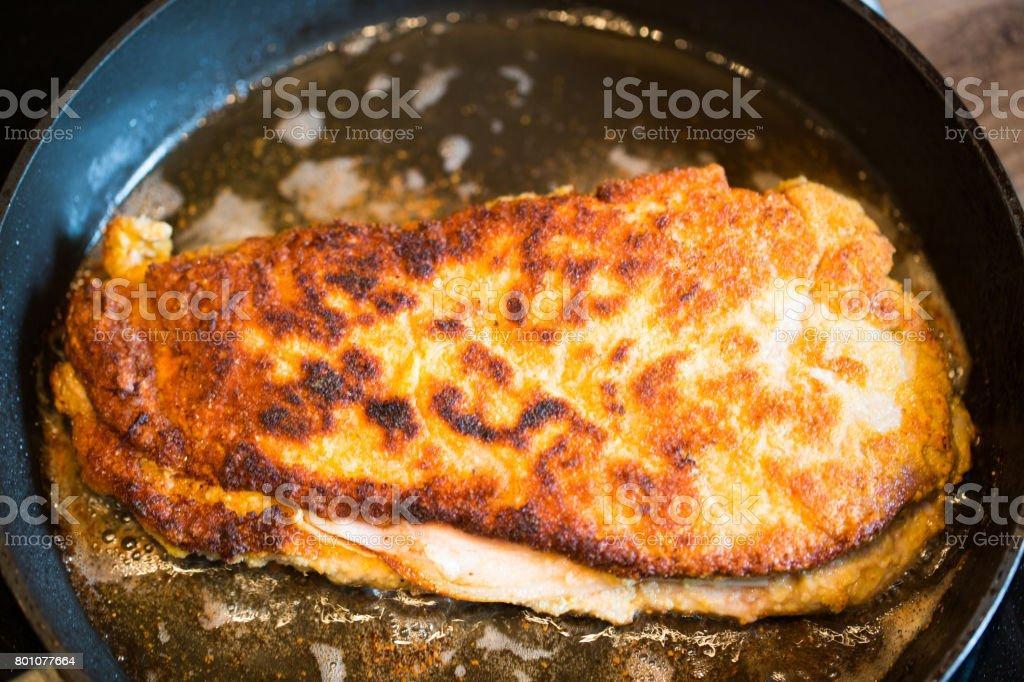 Cordon bleu in the pan on the stove stock photo