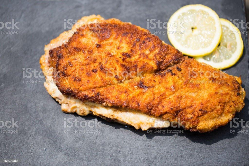 Cordon bleu on slate with lemon and ketchup stock photo