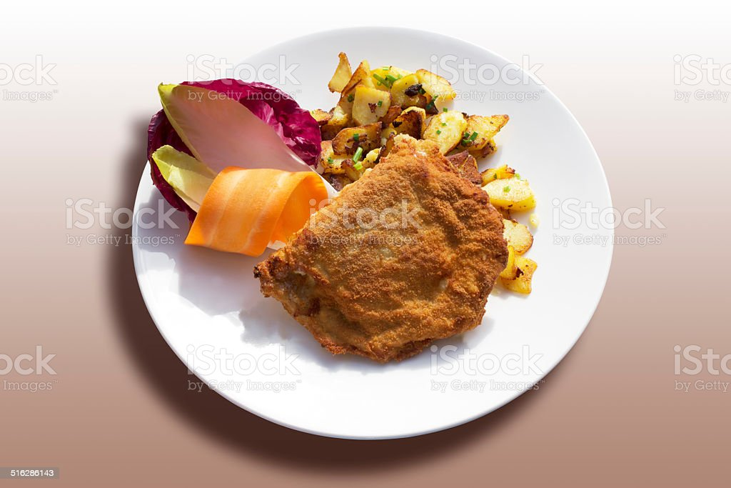 Cordon bleu roasted potatoes and vegetables served on plate stock photo