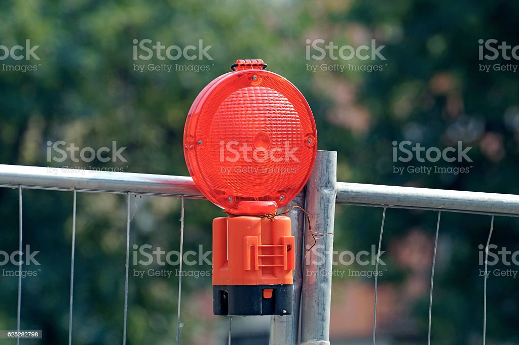 Cordon with warning lights at a construction site. stock photo