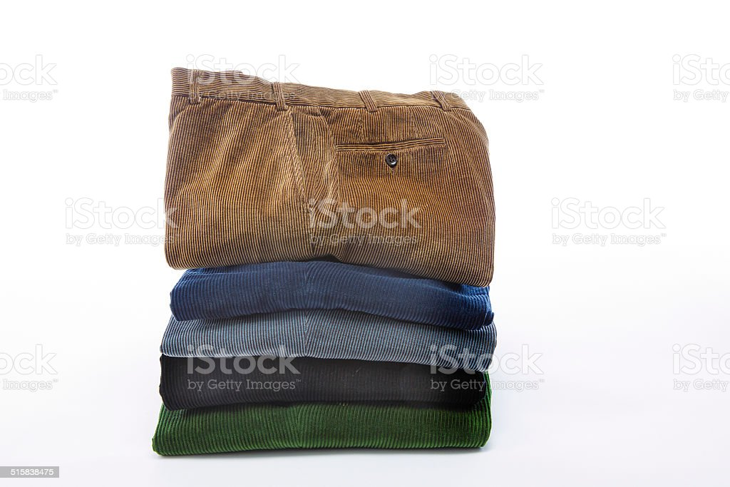 Corduroy pants stacked on a white table stock photo