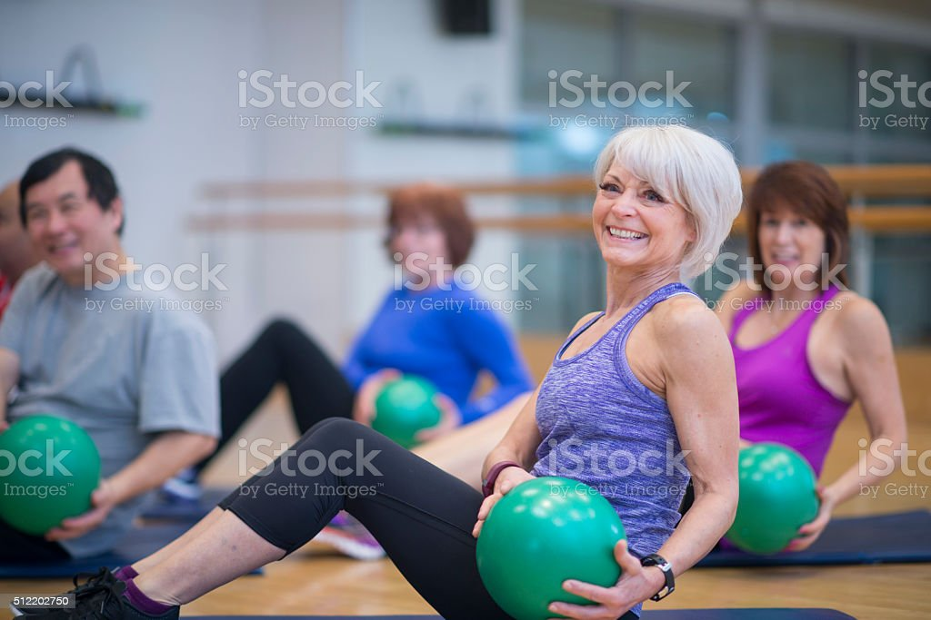 Core Exercises with a Weighted Ball stock photo